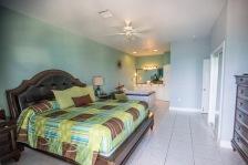 Huge bedroom with jacuzzi & patio doors